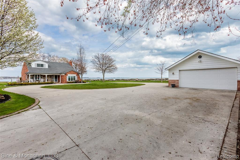 Absolutely INCREDIBLE opportunity to own 240 Feet of gorgeous waterfront property on Lake St. Clair! Super unique location at the end of a peninsula surrounded by miles of water! Breathtaking sunrises flood your home every morning. Large yard over a half acre, with stamped cement patios & walkways, ample parking area and lots space for outdoor entertaining. This charming 2300 Sq ft Brick Cape Cod has a master bedroom on the main floor, office, full bath and three additional bedrooms and another full bath on the second floor. Great eat in kitchen opens up to large living room with natural fireplace.  views of the lake. Great sunroom perfect for hanging out in on those chilly days. Some new flooring, paint, and new sump pump installed. Tons of space for parking! Convenient location close to everything but quiet and secluded . Check out the You tube and aerial video. Please use the address of 35174 JEFFERS COURT IN ANY GPS. Please wear a mask and follow COVID Guidelines.