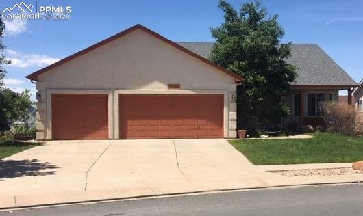 Walkout ranch style home in Wagon Trails *Adjacent to trail and open space *Sprinkler system *3 car garage *Mail level laundry *Main level office *Gas fireplace main and basement levels *Vaulted ceilings on most of main level