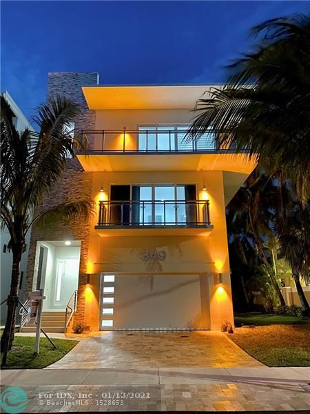 NEW CONSTRUCTION. 4000 sq.ft. A/C, ROOFTOP TERRACE, BOAT SLIP AVAILABLE. Enjoy Intracoastal and ocean views from the rooftop of your home located 1 block from the beach. This luxury residence features 4 bedrooms, including 2 master suites, 4 full baths, a 2 car garage and an elevator. It has three levels of living space plus a rooftop terrace with room for an outdoor kitchen and a hot tub. This is one of 8 detached homes at Seaside Village, a boutique condominium along the Intracoastal on Hollywood's North Beach. Residents enjoy a waterfront pool deck, an Intracoastal promenade and ample guest parking. The low monthly maintenance covers homeowners, wind and flood insurance. Up to 55' boat slip available for an additional purchase.  This is one of only two homes remaining.