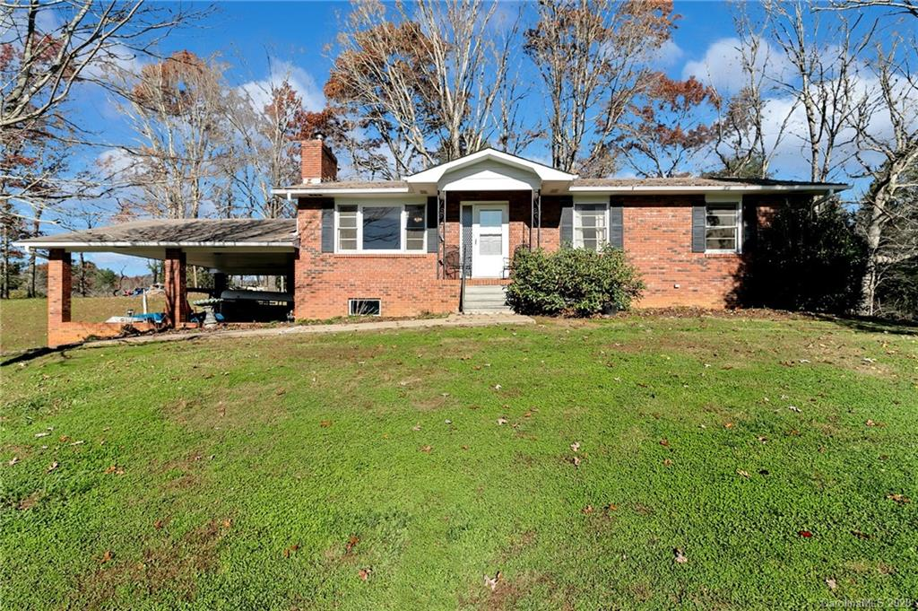 Cute brick ranch with stellar mountain views in the Cane Creek area of Fairview/Fletcher. Home has a full unfinished basement with a huge carport. Great for a workshop/storage area or even possible to finish the basement. Home has nicely appointed rooms. Home could use updating but everything has been very well kept and is in great condition. Home sits on a little over 1 acre and has plenty of room to play. Come see this charming home today. Please schedule an appointment to see the property.