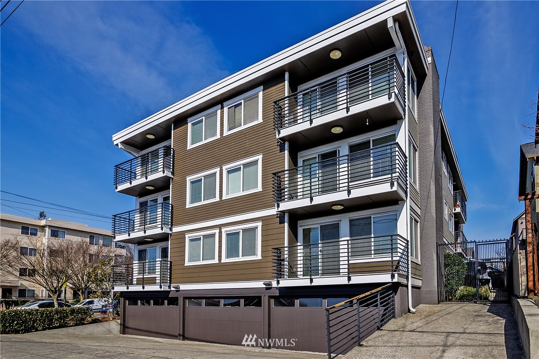 Positioned within walking distance of Ballard's retail core, the property is an 11-unit building that was renovated/upgraded to condo quality in 2007. Features include high-end finishes with in-unit washer/dryers, 6 garage parking spaces, 3 off-street parking spaces, substantial lower-level storage space, and a spacious 3-bedroom/2.5-bath view penthouse, presenting a tremendous opportunity to increase value by converting lower-level storage spaces into two additional apartment units (buyer to verify), and/or by potentially making use of the existing condo declarations and converting the property back to condominiums to sell off individually.
