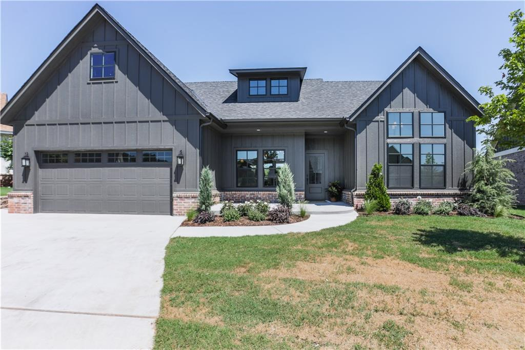 Stunning home currently under construction in peaceful Cottage Grove.  Situated on a beautiful lot that backs to the greenbelt and neighborhood pond, it is the first of this floor plan to be built in the neighborhood.  With unique finishes, gorgeous wood beams, and graceful arched bookcases and doorways, this house is one of a kind!  The open, airy living room and kitchen are perfect for entertaining.  You'll love the master suite with office nook and massive walk in closet that connects to the laundry.  This spacious split floor plan offers plenty of room for everyone.  End your days on the back patio with fantastic views of the wooded greenbelt and pond.  Come experience Edmond's charming Cottage Grove.