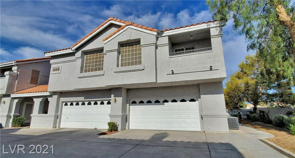 """Freshly Painted. Corner 2-story Condo/Townhome with unique upgrades. 16""""Travertine Tile Floorings on the ground level. 2-tone Custom Paint with crown moldings and 4"""" baseboard. Den can be converted to a 3rd Bedroom. Full bath downstairs. Dedicated spa room with Jacuzzi and rain shower. Upgraded granite tops in the kitchen. Dual Master Bedrooms upstairs. Master bedroom has a unique sunroom. Access to desert landscape in the backyard."""