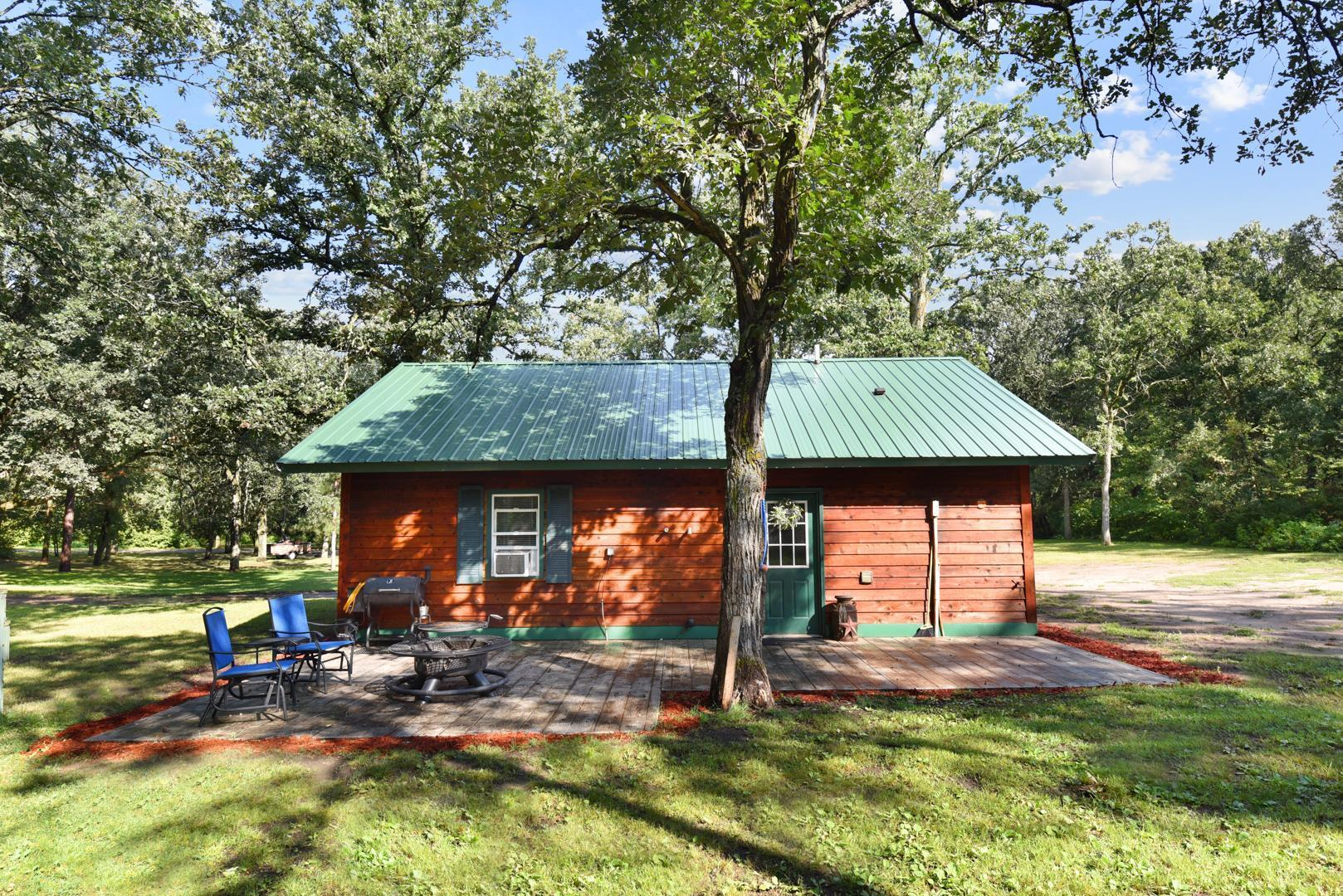 Country living yet close to town.  Don't miss this two bedroom, one bath home on a 2.5 acre wooded lot. Home features a new metal roof, wood siding, main floor laundry, deck and ceramic tile. Recent renovations make this home move in ready!