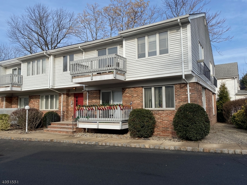 Spacious First Floor 2 Bed 2 Bath unit located in the heart of town, updated kitchen with maple cabinets and granite counters . Eat in dining area, Formal DR/Living combo, Kitchen slider to deck, storage room in full Bsmt. Water included in maintenance fee