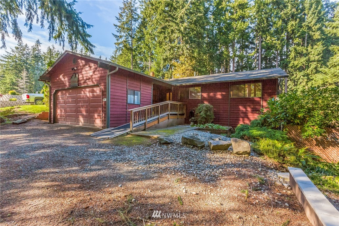 Private, Serene Backing to Treed Open Space. In Lakeridge w/Lake Tapps access in Jenks Park, Boat Launch, 3 Parks & More! Open Floor Plan w/Tons of Potential. Beautiful Yard w/Towering Evergreens, Blooming Shrubs, Flowering Bushes + Small In-Ground Pool.  Outbuilding for all your Tools & Toys. Hardwood Floors, Rock Fireplace w/Pellet Stove. Wall of Windows w/2 Sliders to Lrg Covered Deck. Kitchen w/Tile Counters, Gas Range, Knotty Pine Cabinets, Wood Slab Bar w/Rough Edges. Gas Heat & Hot Water.