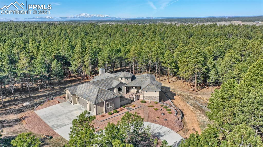SIMPLY GORGEOUS!! The sky is truly the limit for this 35 treed acres property surrounded by National Audubon Society conservation acreage. This home will captivate you the moment you arrive. Entering through private courtyard. Gaze at the breathtaking wood floored main level loaded with everything imaginable. Step inside and be ready to be captivated by the dramatic tiled circular entry with huge chandler, custom stained glass in the atrium. A gourmet kitchen, complete with granite counters, alder cabinets, 6-burner gourmet gas stove, huge counter island and built in Thermador refrigerator and freezer. Living room accented with gas stone fireplace and walkout to the  deck with 30X20 patio underneath. Luxury master suite with huge walk-in closet, oval tub, and custom tile shower. Main level walkout study with built in bookcase. Beautiful formal dining area with views of front courtyard and Barrel Wood ceiling and plaster walls. Full finished walkout basement highlighted by family room with full huge wet bar, wood burning stone fireplace and luxury vinyl flooring. Oversized 4 car garages, fully functional barn, 4 stalls with domestic well and separate water source. All of this is fully fenced and parceled. See how beautiful life at this spacious property can be just TOTALLY AMAZING!!
