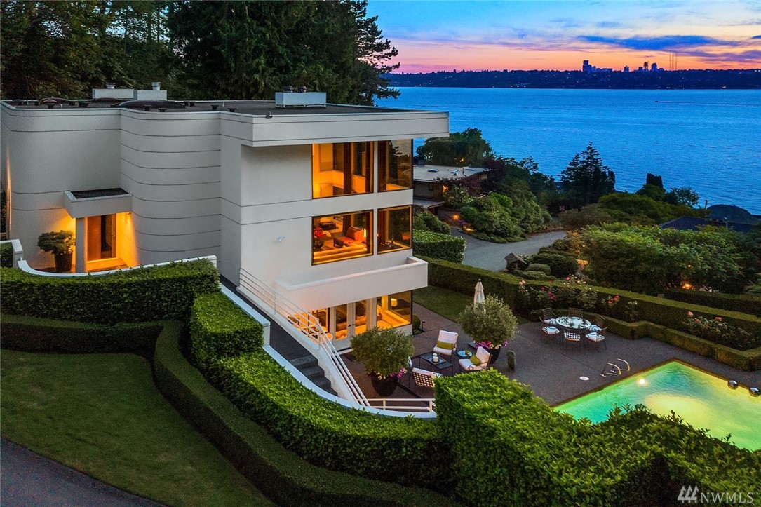 Sculpture House... Prominently positioned on one of Medina's most desirable streets to take full advantage of the incomparable western views of Lake Washington & the Seattle city skyline. Designed by esteemed Northwest architect Vassos Demetriou. This trophy estate was created to entice the senses. Effortless indoor entertaining spaces connect seamlessly with the boxwood framed  pool and spa. Full top floor master suite and library. The ideal canvas for a luxury lifestyle. Incomparable.