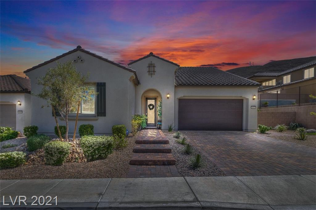 """Welcome to """"The Cove"""". Southern Highlands Newest Community Tucked Away On The Moutain Side. This Stunning 3 Bed/3 Full Bath Plan Has Been Barely Lived In! Home Features 10 Foot High Ceilings With Gorgeous Crown Molding Throughout, Plantation Shutters & Custom Foyer Ceiling.  Kitchen Has Brand New Stainless Steel Appliances, Large Island, Pantry & Tons Of Cabinetry!! Garage Has Epoxy Floor & Tankless Water Heater. Master Bathroom Features Beautiful Stonework Over The Tub! Hurry Up And Get To """"The Cove"""" & Enjoy All Of Its Resort Style Amenities (Community Pool/Spa, Gated Grounds, Parks, Jogging Paths & Much More). Seconds From St Rose Pkwy & All Of The New Shopping/Restaurants/Raiders Practice Facility / Costco That Has Opened Up. Great Access To The I-15! Be Anywhere In Town In Less Than 20 Mins!"""