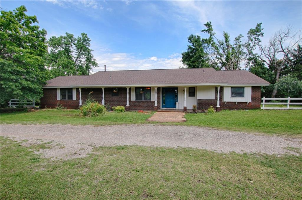 This 3 bed, 2 bath house (1241sq ft) has a garage conversion (additional 528 sq ft) with closet for use as an extra bedroom, bonus room, or study.  Home sits on 2 acres (mol) with an approx. 35x36 ft (buyer to verify size) barn/outbuilding with electric that could be used as a garage/shop.  Master bedroom has an en suite bathroom with newly tiled shower and floors.  New roof on 2021, and new septic in 2019. Great area with many higher end homes/additions nearby.  Quick access to the turnpike and I-35.  Fridge, washer, dryer, and riding mower are negotiable.