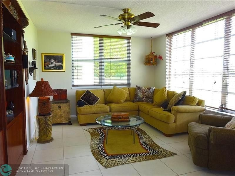 Spacious corner condo with large master bedroom, bathroom and with walk-in closets. The third bedroom has many options; it can be used as an office/den or bedroom. Tile floors in living areas, come relax on the balcony and enjoy the serene golf views. Multiple heated community pools. Palm Aire has golf, tennis, walking, biking, playgrounds. Centrally located minutes to I-95, the turnpike and area beaches.