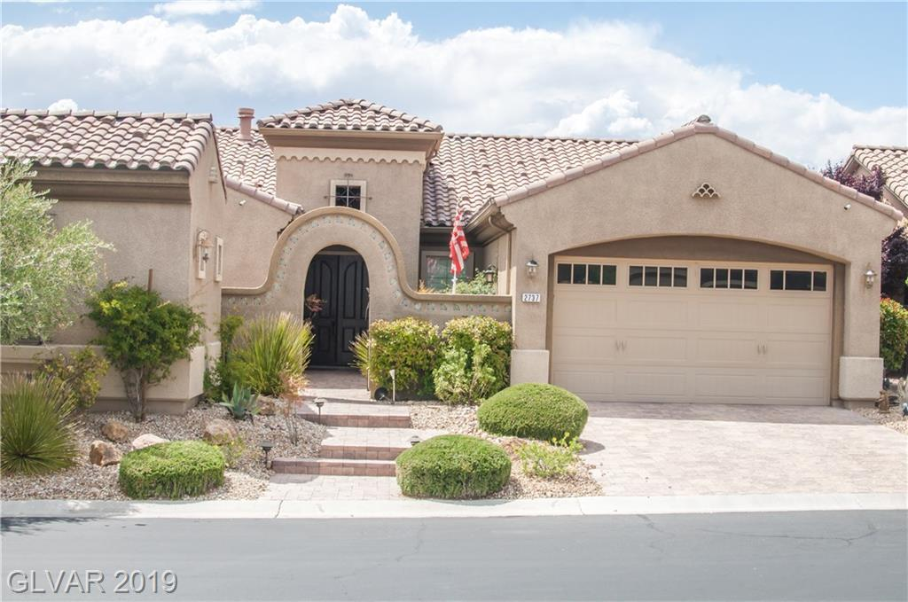 Fully upgraded former model home with pool and spectacular mountain and city views in guard gated Club at Madeira Canyon. Home is walking distance to club house. Upgraded ceilings, security with 4 cameras, GE Monogram appliances, & Fisher&Paykel dishwasher.  Travertine and engineered wood floors. Master has walk in closet with built in cabinetry.  Plantation shutters throughout the home.  Casita w/bath and brick paver courtyard. Move in ready!!!!