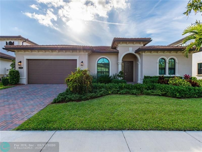 "Elegant one story home located in guard gated Watercrest offers a dramatic open feel & allows for grand entertaining & easy living. Formal living room.  Great room combines kitchen, dining & family room  to create an open floorplan layout with expansive windows & sliding doors leading to fenced backyard &  screened patio  where you can enjoy beautiful sunsets. Room for a pool & swing set. Over $70k in upgrades. Detailed to perfection! Chef dream kitchen with 30""l gas cooktop, SS appliances, 8x6 island & walk in pantry.  Bonus room den/office/dressing room or 3 car garage. Gray Pine ceramic tile throughout. Wood floors in bedrooms. Custom closets. Impact windows & doors. Clubhouse across the street offers resort style pool, basketball,  tennis courts and gym. See attached Feature List."
