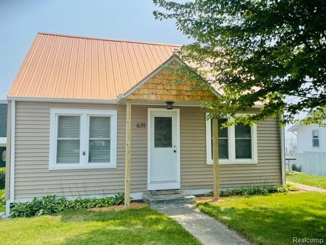 This waterfront property has been recently updated and offers more than you can imagine! Daily lakeside sunrises and continuous water views are just the start. It's located within walking distance of the local parks, beach's and pier and across the street from the canoe & kayak launch. Downtown Tawas is also right there for food, entertainment and shopping.  There's a spacious 3 bedroom, 2 bath family home as well as a 625 square foot 2nd home with 2 bedroom, 1 bath, full kitchen bungalow house that sits within 50 feet of the waters edge.  The sound of the waves crashing never stops at this perfect up north get away!