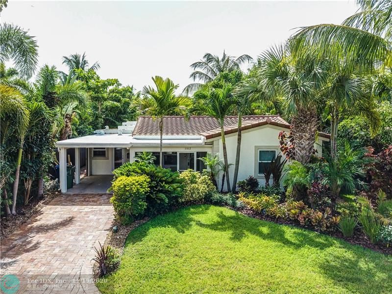 This beautiful 4 bedroom tropical oasis has so much to offer.  House has been fully renovated.  Your own private paradise comes with new porcelain flooring and wood baseboards and custom crown molding throughout the home, solid wood interior doors and high impact doors and windows. The bathrooms have been fully remodeled and new custom kitchen cabinets, lighting, quartz countertops, backsplash, Kitchen Aid refrigerator are currently being installed.  In addition to the stunning interior of the home, the backyard offers your own personal nirvana.  Newly landscaped with landscape lighting, pool with freshly installed pavers and driveway, screened porch and deck provide the ideal atmosphere for entertaining.  A short 17 minute drive to FLL airport and 10 min from the gorgeous beaches of FLL.