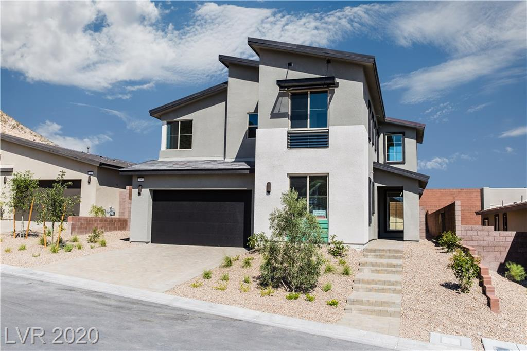 Tastefully upgraded-Modern, Open concept home located in the Cliffs Village of Summerlin South. Indoor/outdoor living at it's finest! Quartz countertops, designer cabinetry and flooring, stainless steel appliances, wet bar at den, large covered patio, stacking doors, bedroom w/ full bath on first floor.