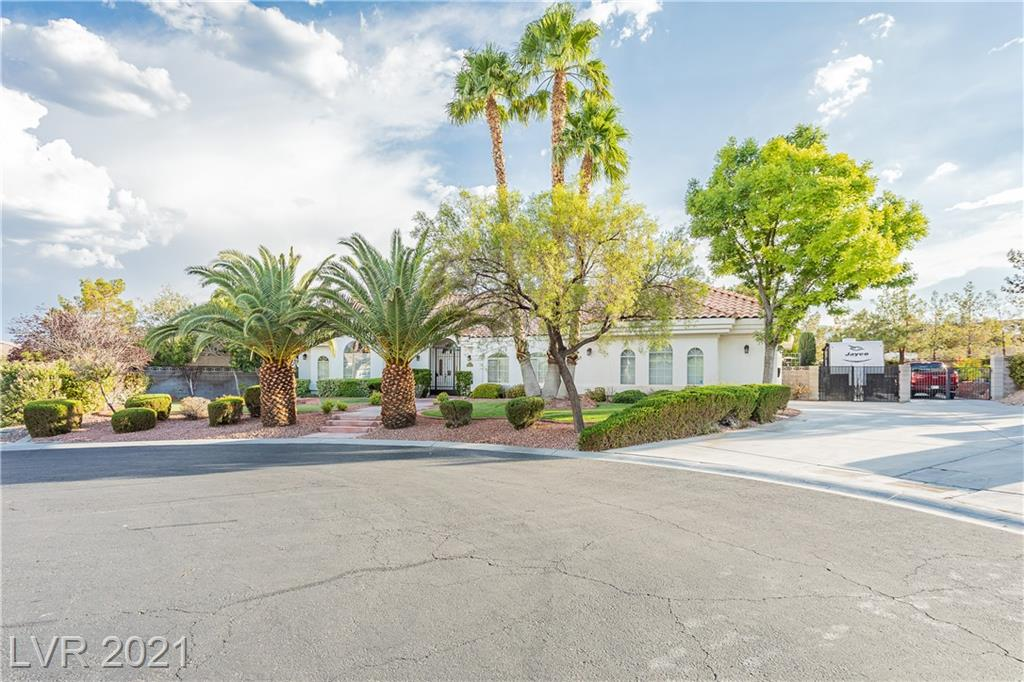 Single Story gem in a non-HOA community in the Northwest area of Las Vegas! This 3,067sqft home features 4 bedrooms, 3 bathrooms, a den, a formal living room, 3 car garage, RV parking, and an immaculate backyard that will make you never want to leave home! Stunning high ceilings! Amazing open kitchen with granite countertops, breakfast bar, and stainless steel appliances! Primary Suite features a custom walk-in closet, separate shower & tub, and access to the backyard oasis! The backyard is nothing but ready for your summer gatherings with it's stunning pool and spa, covered patio and mature landscape! Impeccably clean and move-in ready. This home will not last!