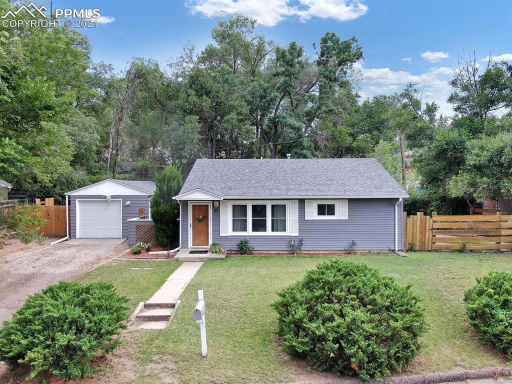 Charming, RECENTLY RENOVATED rancher on a huge lot. New plumbing 2020. Foundation Drain 2020. Roof over sunroom in 2018. Plenty of interior finishes have been beautifully upgraded. Enjoy the large fenced backyard, great for entertaining. The large mature trees provide lots of shade in the summer. The Sunroom features a freestanding gas fireplace to keep cozy and is a great additional living/relaxation space. The kitchen was completely redone and includes new appliances, cabinets, counters! NEW FLOORS & PAINT throughout the home as well. Bathrooms have also had a make over. The home also has a Storage shed, oversized 1 car detached garage, RV parking and low maintenance vinyl siding. Central air is great for those hot summer days. This home is conveniently located in Cheyenne Heights, close to the Broadmoor, shopping, dining, downtown and military bases. Take a walk to the newly added retail center! This one is a gem.