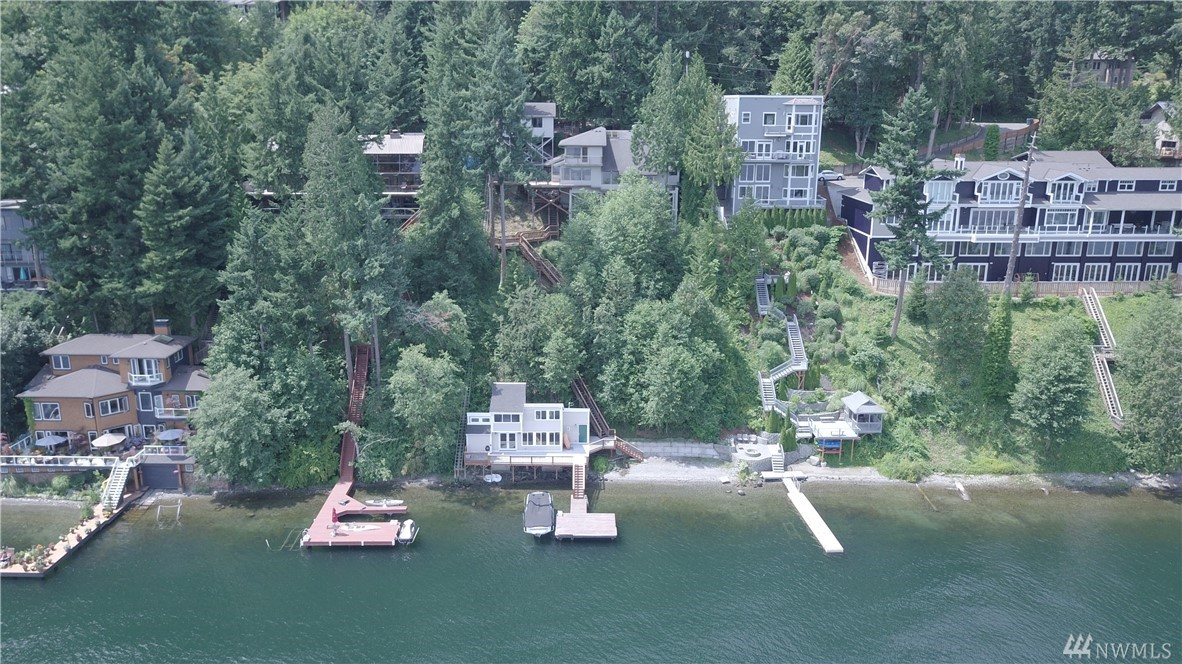 NEW PRICE! Eagle's Nest retreat featuring fantastic lake views, fully remodeled beach house, 100 ft of lakefront, and a BRAND NEW TRAM installed end of September. Spacious 3,420 sq ft, 4bd | 2.25ba, main house perched above the lake. Live, relax, and take in the views. Then head down to the 800 sqft 1bd | 3/4ba lake house and enjoy the water! Huge 18,102 sq ft lot, private dock, boat-lift, large deck, and minutes to downtown Bellevue and Redmond. Live+Work+Play. Your new home is waiting for you!