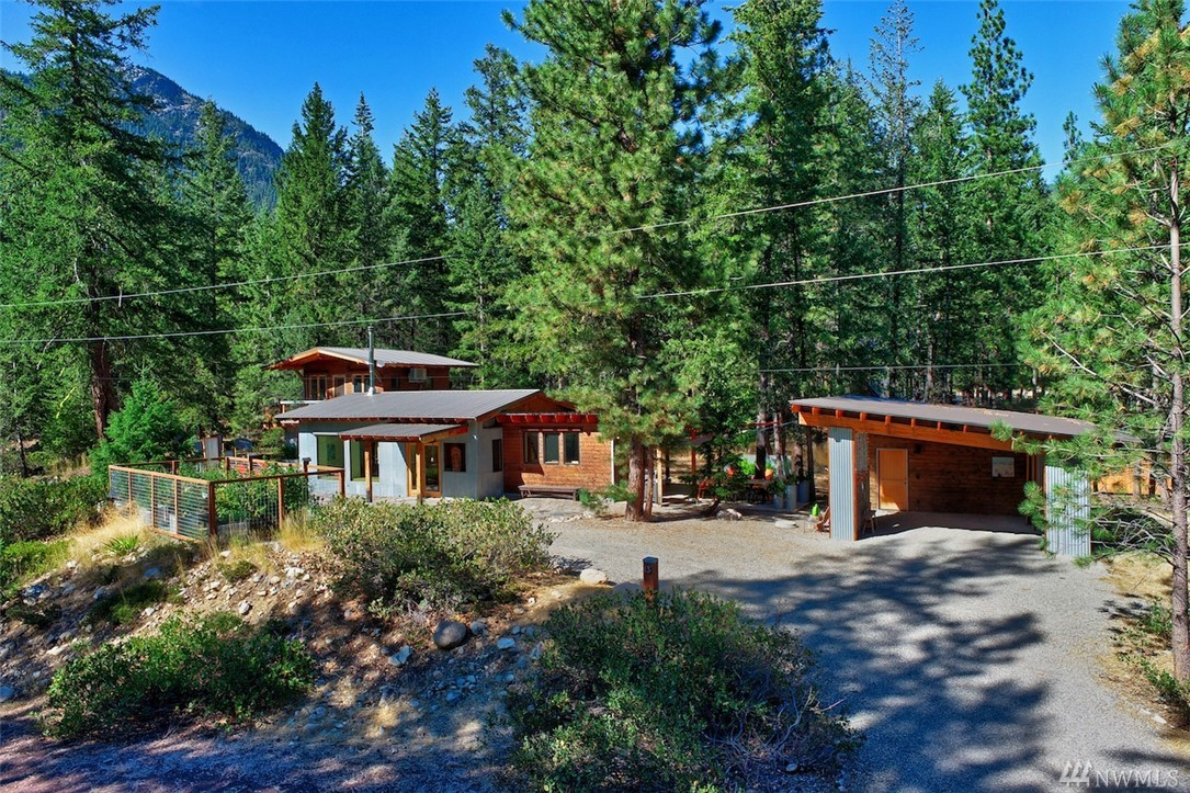Private Mazama retreat in the woods! 2006 custom design-built home on 1 acre. Light-filled great room, German wood stove. Home chef's paradise! Updated kitchen, new appliances, fenced garden. 2 Bed. Large 3/4 BA. Den offers flex space. Home office w/sep entry. Radiant heat & ductless mini split. Detached carport w/large studio & deck. Hot tub, outdoor shower, fire pit, alfresco dining: Outdoor entertaining spaces galore! Includes most main floor furniture + more! Start living your Methow dream!