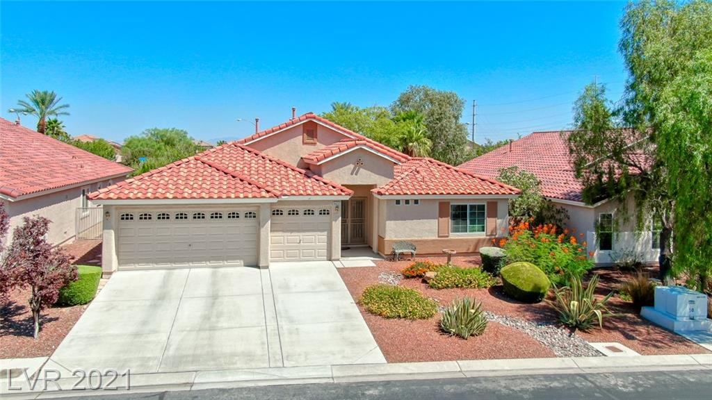 Must See Beautiful North Las Vegas Home! This Single-Story Home Has It all Including a Shimmering Pool! Take In The Vast Vaulted Ceilings, Admire The Fresh Paint, And Upgraded Lighting Fixtures. Step Into The Large Front Bedroom Suite With Attached Ensuite, Which Is Perfect For Guests, Or Multi-Generational Living. The Formal Dining Area Is An Amazing Place To Enjoy A Meal With Family, And Can Accommodate A Sizable Dining Table For Those Who Like To Entertain Dinner Guests. Prepare Magnificent Meals In The Updated Kitchen Boasting Matching Stainless Steel Appliances And Beautiful Backsplash. Relax In The Family Room And be Immersed By The Built In Sound System. The Spacious Primary Bedroom Faces The Private Backyard, Custom Closet, And Ensuite With Separate Shower And Bath Tub. Two Additional bedrooms On The Opposite Side Of The Home Provide Privacy And Plenty Of Space For Family Or Guests. The Shimmering Pool Is Accented By Mature Desert Landscaping and Has A Large Covered Patio.