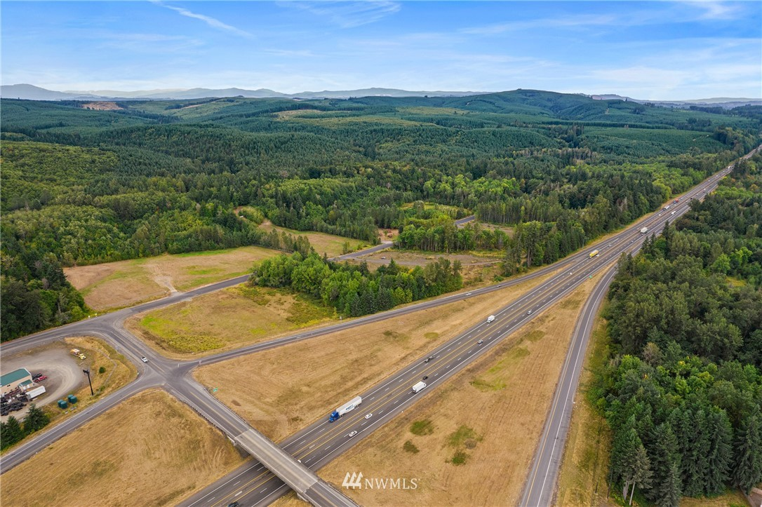 PRIME I-5 COMMERCIAL land centrally located between Seattle and Portland (exit 57) with immediate access off I-5 that is ready for development!  Sale includes 3 parcels that total 11.98 acres with permitted uses such as a gas station/convenience store, motel, and/or restaurant to name a few.  Master site review is in process with the county, critical areas all resolved with no issues, proven availability for septic system, a class B well in process of being installed, and 3 phase power and high-speed fiber internet at the street.  Owner financing available too.