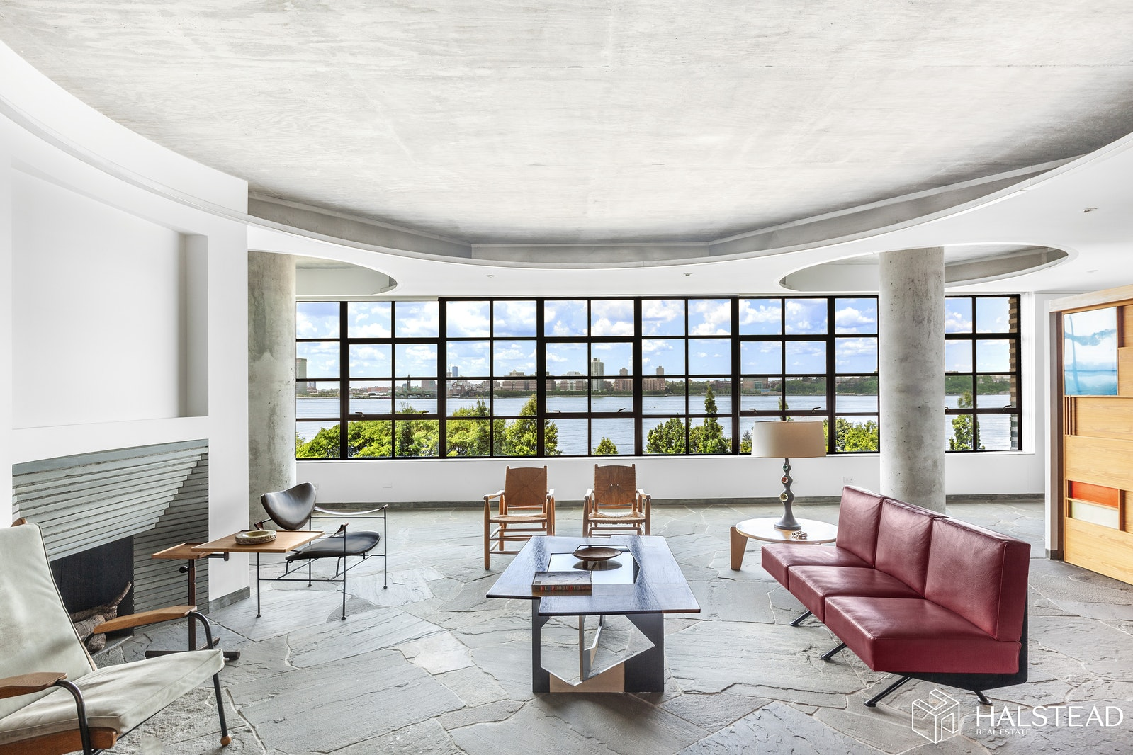 "Enjoy brilliant light and uninterrupted Hudson River views from 64-feet of continuous steel ribbon windows in this rare and sophisticated full-floor loft located in Carey Tamarkin's highly coveted 495 West Street - the ultimate private West Village waterfront address! Designed by Robert Marino and inspired by the French mid-century industrial aesthetic, this singular residence features an open flexible floor plan and is a study in the creative expression of architectural materials and the interplay of form and light. A keyed-elevator entrance leads to a dramatic sun-drenched entertaining space with heated bluestone floors, a wood-burning fireplace, a custom wet bar and mesmerizing water views as far as the eye can see. Concentric circles on the ceiling, underscored by concrete columns, pay homage to the great French designer Jean Prouve and define the flexible living areas below including a large Library with custom bookshelves and a sun-filled lounge, both of which can easily be reconfigured into second and third bedrooms. The oversized eat-in-kitchen, with expansive views of the river and lush tree-tops of the Hudson Waterfront park, offers custom milled cabinetry and state-of-the-art appliances. The spacious and bright corner Master Bedroom suite is a serene sanctuary with a large walk-in closet and a windowed en-suite Master Bath, both in keeping with the home's mid-century design vision. The entire loft exudes a sense of calm and stillness enhanced by the meditative effects of the ever-changing Hudson River with its magical sunsets and the twinkling lights of the New Jersey shoreline in the distance. Additional amenities include multi-zoned central air-conditioning, a separate laundry room, copious amounts of storage, and custom Lutron lighting on dimmers throughout.All this, in a rare, full-floor boutique condominium on the Far West Village's ""Gold Coast,"" where residents enjoy protected views of the Hudson River and the kind of privacy and anonymity that are ensured by a key-locked elevator and 24-hour doorman. The building is located directly across from the Hudson Waterfront Park and is steps from the cobblestone charm of the historic West Village, the sought-after restaurants and boutiques of the Meatpacking District, The Whitney Museum, The High Line, and all that is Downtown. Truly one-of-a-kind!"
