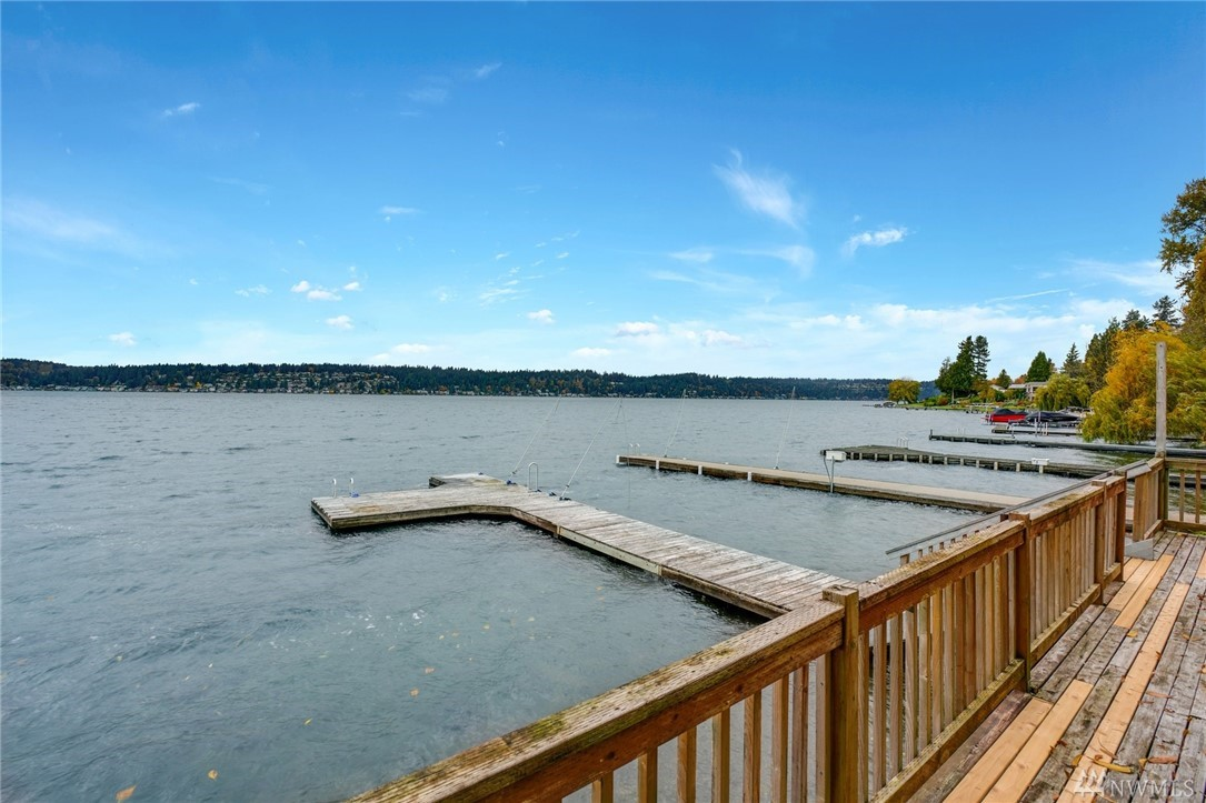 Opportunity to live on Lake Sammamish, 50' rare waterfront home with private dock and moorage. Sweeping West facing views of the lake. Value in Land, 2 lots. Minutes to retail & dining. Close proximity to Bellevue, Redmond, Issaquah, Marymoor Parks & more, w/access to renowned Lake Sammamish Trail. Enjoy summer leisure on the water, private location on Lake Sammamish and West facing lake-view sunsets. Total lot Sqft 20,186 Zoned R4. Water/sewer connected. Double List MLS. Build your dream home.