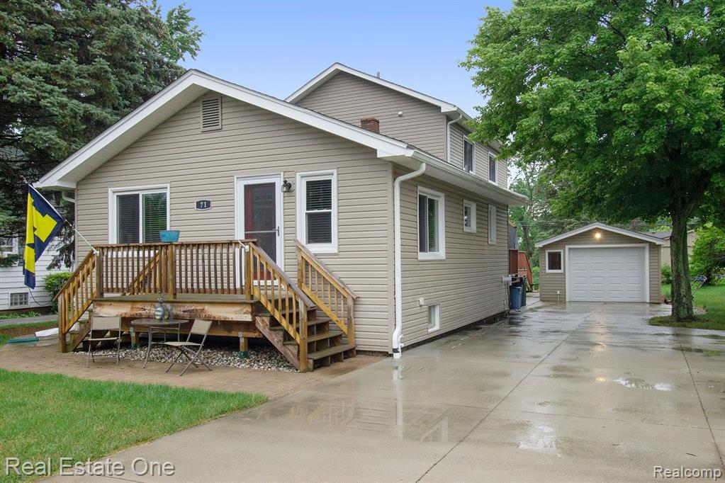 A TRULY UNIQUE HOME IS NOW AVAILABLE WITH SO MANY POSSIBILITIES TO USE AS YOU WISH. 3 NICE SIZED BEDROOMS ON THE MAIN FLOOR AS WELL AS 2 FULL BATHS AND 2 KITCHEN AREAS (seller's used as an in-law area) ADJACENT TO A 2ND LIVING ROOM. THE DOORWALL ALLOWS ACCESS TO THE LARGE BACKYARD DECK ADORNED WITH A MARY GROVE AWNING (with recessed lighting) TO ENJOY THE OUTDOORS. THERE IS A LAUNDRY AREA ON THE MAIN FLOOR AS WELL AS IN THE BASEMENT. THE SECOND LEVEL IS WIDE OPEN WITH A FULL BATH SO YOU CAN USE AS A PRIMARY BEDROOM/ENTERTAINMENT AREA OR WHATEVER YOU DESIRE - THERE IS A WET BAR AREA OR CAN USE AS A BREAKFAST BAR IF USING AS A BEDROOM. AS YOU CAN SEE.... THE POSSIBILITIES ARE ENDLESS!