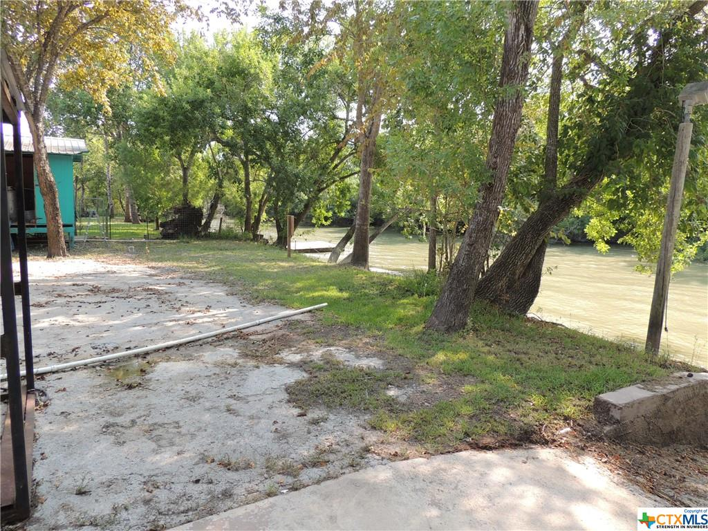 GUADALUPE RIVER FRONTAGE!!! This listing consists of a 14 tap RV park with well stocked pond and a 50' x 75' metal building with a canopy and 5 additional taps. Each RV space is 75 feet. The laundry room includes 2 washers and 2 dryers. It also includes a 3 bedroom, 2 bathroom, 1838 square feet 2012 Fleetwood with double paned windows, porches and a new AC. 2 water wells and a 2 boat launches on the property. The road grader is included in sale. There is open parking on both properties.