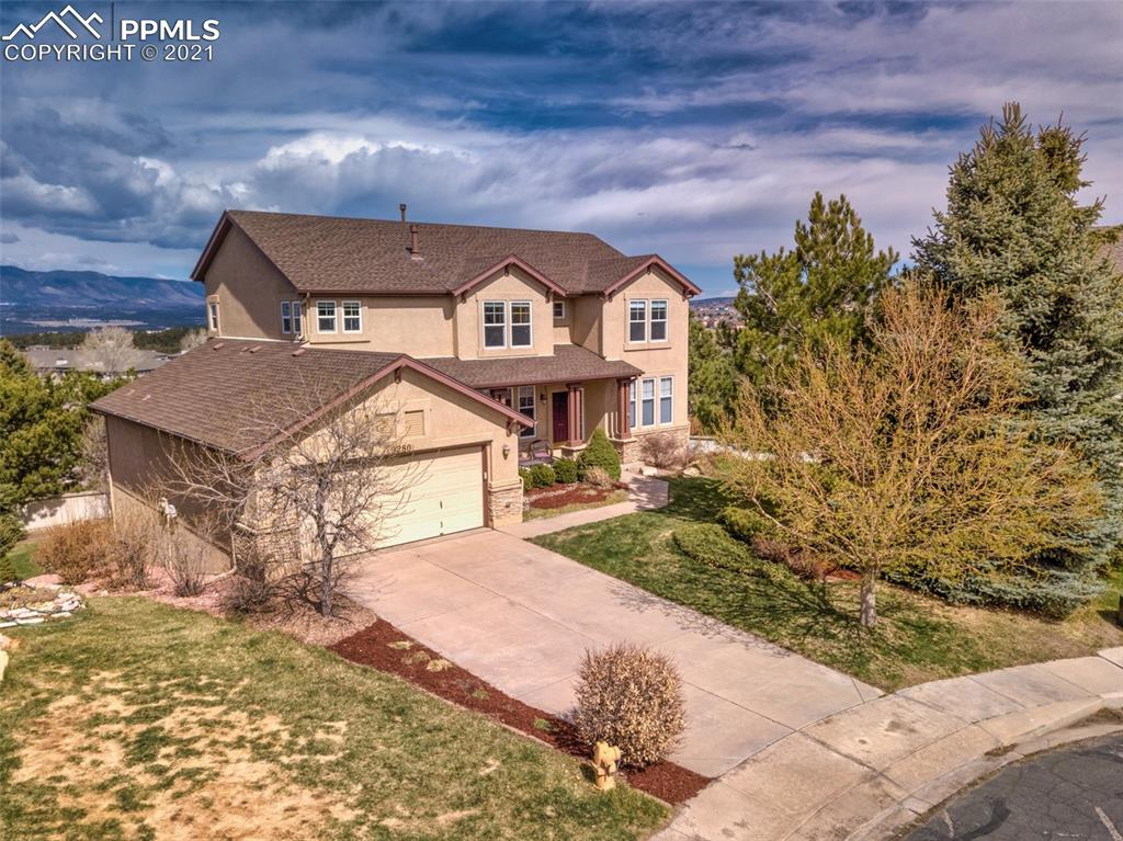 Unobstructed Views of Pike's Peak all the way to the Chapel at the Air Force Academy! Then to top it off if you're looking for a great entertaining space this is the home for you! Conveniently located in Summerfield near Briargate.  Main level features a gas fireplace in the open-concept living room that flows into the kitchen with a granite island.  Adding to the entertaining space, there is a great-sized walk-out deck off of the kitchen area, perfect for grilling and taking in those breathtaking mountain views!  A laundry room, formal dining room, office, and sitting area near the entry make up the main level.  You'll have a five-piece master bath with a walk-in closet that adjoins the master bedroom upstairs, in addition to 3 more bedrooms leaving plenty of room for your family or guests. On the lower level you'll have a walk-out to the back yard, a spacious family room, bedroom with attached bath, and a spacious utility closet storage space that could be converted to a 6th bedroom.  3-car garage is 2-door tandem allowing for maximum use of space.  Location to and access to military bases, shopping trails, and parks and District 20 schools.  This will be the place you'll want to call home.
