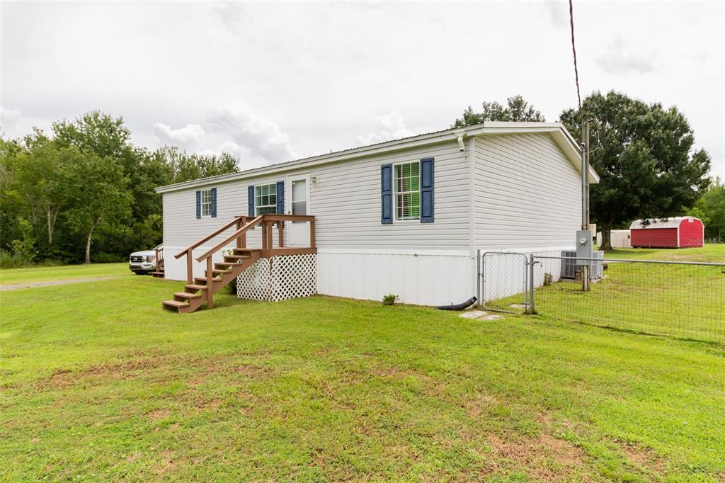 **PRICE IMPROVEMENT** Are you looking for elbow room? Look no more! Welcome home to this very well kept 3 bedroom 2 bath manufactured home. This home offers an open split concept with a large kitchen, breakfast nook, laundry area, formal dining area and large living room! A few notable upgrades to this home include but are not limited to: Newer Roof (3 yrs. old), AC, vinyl laminate flooring through out, handicap access added to the large back porch. This home has a gorgeous back porch suited for entertaining. Situated on 1.77 acres of land there is plenty of room for ALL of your toys or animals in the fenced in yard! Please note there is a dog kennel with a concrete foundation and a shed that will stay on the property. It is hard to find space these days! Book your showing quick.