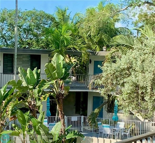 Wonderful 2nd floor corner unit in highly desirable community over looking park setting where you can enjoy walking your pets. Condo located within walking distance of Wilton Drive and close to the beach, shopping, restaurants and nightlife. Unit just professionally painted through out including doors, trim and bathtub and surround just reglazed. Beautiful kitchen with black & stainless steel appliances. This unit offers low maintenance fee, pool with grilling area, on site laundry, bike storage, community room and soon to be installed H/D security cameras in common areas. Owners my have up to 2 pets but combined weight many not exceed 65 lbs and breed restrictions apply. - High impact doors and windows installed in 2018. Outside of complex was updated in 2018.