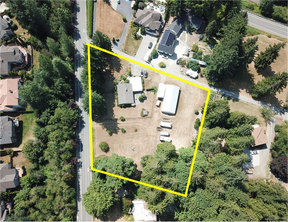 Builder Alert. First time on the market in 45 years. 1.37 acres (60,090 sqft) of flat, dry land zoned R-4 just off of Lake Sammamish. An incredible benefit of this property is that it has one private community beach right on Lake Sammamish. The community beach has a convenient and rare boat launch for the east side of the lake and shared boat slips. Value is in the land. Existing home on the property is sold as-is. Buyer to verify potential subdivision and development options. Location, location, location. Near shops, dining, parks, trails, Award Winning Lake WA Schools, SR-520 & Microsoft.