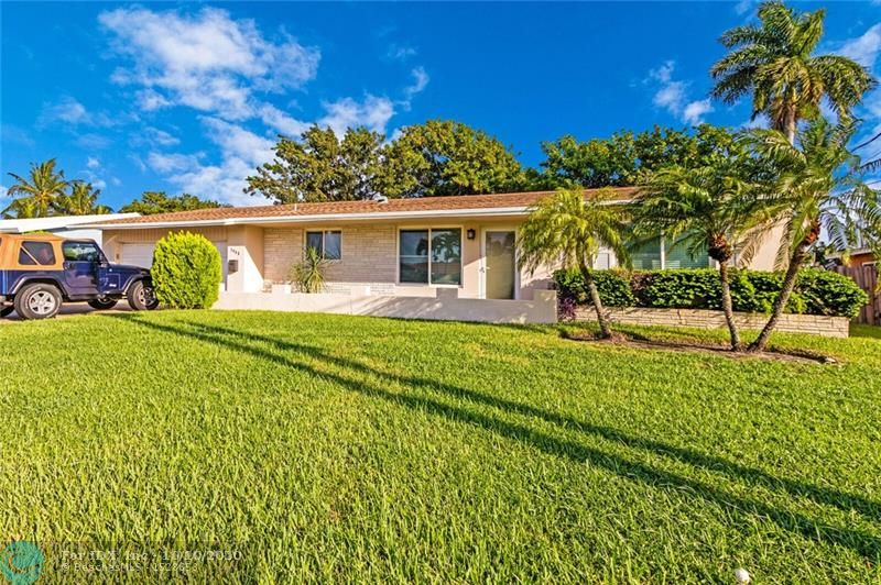 A great new opportunity just came up to own in East Ft Lauderdale in the prestigious Coral Ridge Isle neighborhood. This Spacious & Tastefully updated Home boasts GREAT Square Footage, Tile Flooring, Knock Down Ceilings & Walls! Updated Partially opened Kitchen with modern Stainless Steel appliances, Wood Cabinetry & over sized Granite Counters perfect for any discerning Chef. Huge Master Bedroom En-Suite with additional Sitting/Office area... BOTH bathrooms have been completely Upgraded as well. All Impact Windows & Doors in 2013. Nice Pool with entertaining space for Friends & Family as well as fenced yard, ideal for pets & little ones... Large 2 Car Garage. Additional building with Bonus space that would be perfect for Home School/Home office. New Roof in 2011. This will go fast!