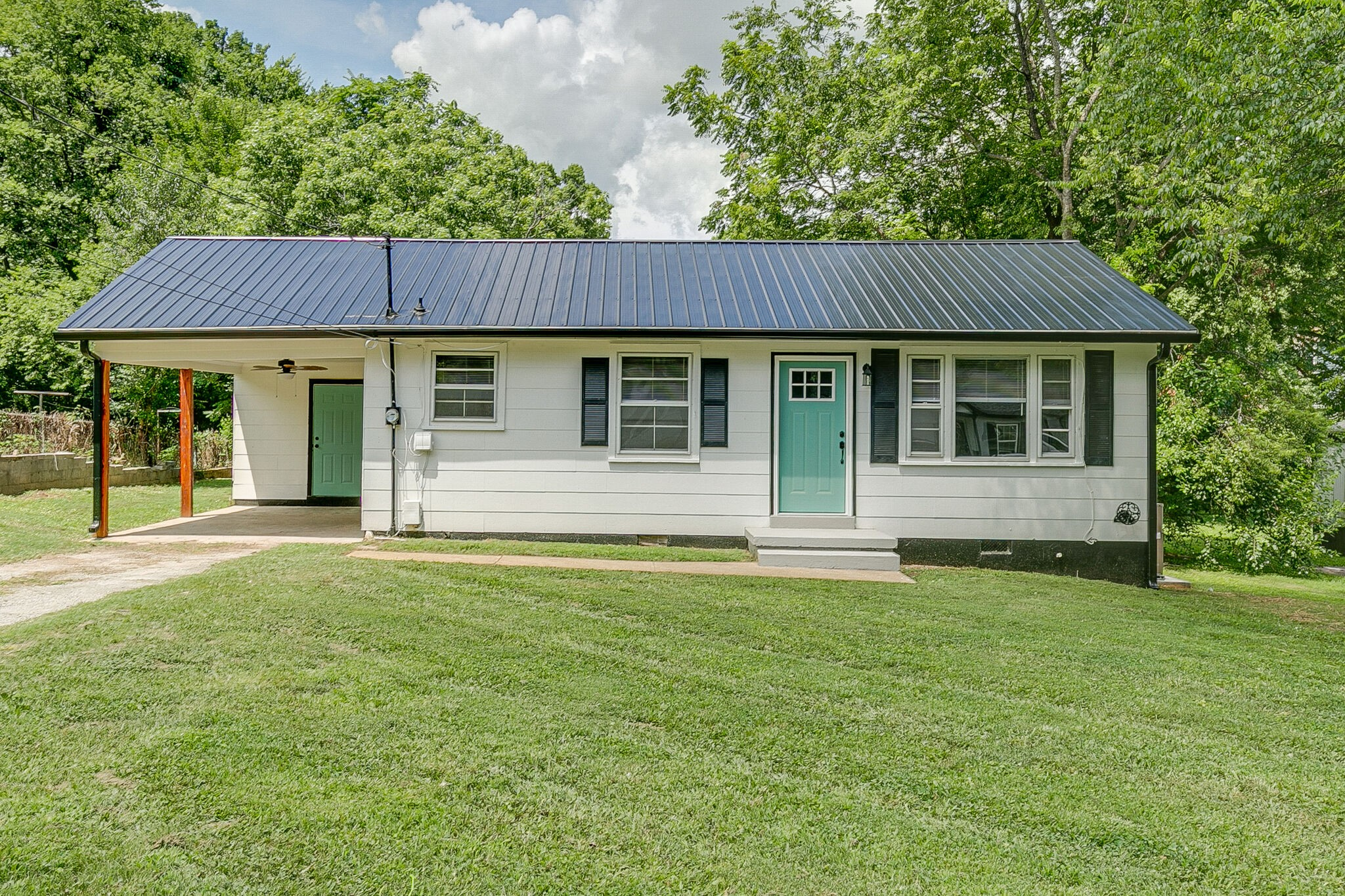 Gorgeous, sand and finish hardwood floors in this home! Quaint 2 BR/1 BA with spacious yard. Great starter home, includes all appliances including washer/dryer. New roof and HVAC. Priced below many of the new homes in the neighborhood.