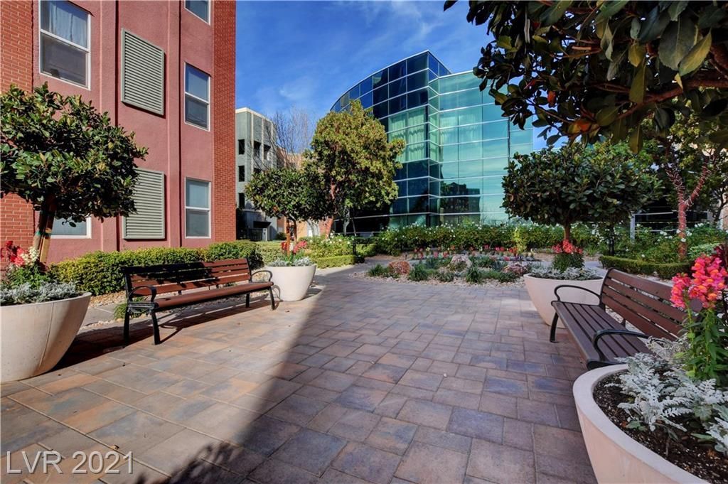 Come home to a beautiful condo that's an end unit on the 3rd floor. Spacious one bedroom with tall ceiling so you don't feel cramped. Newish carpet throughout. Ceramic tile in the kitchen and bathroom. One underground assigned parking space comes with the unit. The community features 24/7 security with a guard gate and roving guards. Cancel your gym membership because the fitness center is open all the time with great equipment. Easy access to the Strip, the airport and the 15 freeway. Want to catch a Raiders game at T-Mobile? Easy peasy bus access on Las Vegas Blvd will take you there.