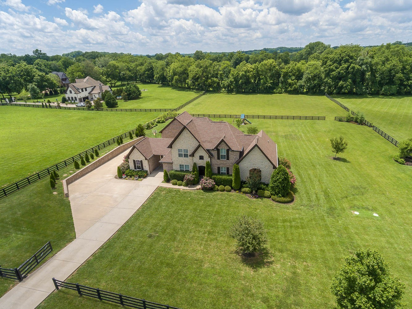 Located in beautiful equestrian community w/sweeping views of fenced pastures, open floor plan home features new luxury kitchen w/Bosch, quartz & wine fridge that opens to cozy great room w/stone fireplace & french doors to patio. Stunning master wing  has private office (or 5th bedroom) & bedroom suite featuring GORGEOUS spa bath w/clawfoot tub! Room for everyonel w/2 add'l 1st flr guest beds PLUS 2 more bedrooms up w/bonus rm & game loft!  Stunning 5.6 acres perfect for pool, barn & horses!