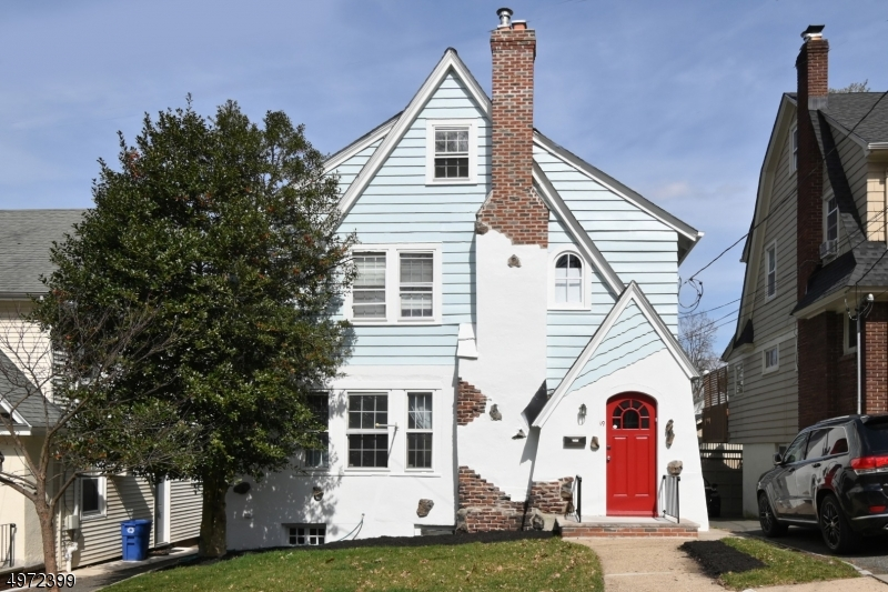 BRIGHT, SPACIOUS 4BR 3 FULL BATH TUDOR FEATURING 4 FLOORS OF LIVING SPACE INCLUDING FINISHED BSMNT. HARDWOOD FLOORS THROUGHOUT, FIRST FLOOR DEN, EAT-IN-KITCHEN, BRND NEW STAINLESS STEEL APPLIANCES WOOD BURNING FIREPLACE, CHARMING BUILT-INS, ATTACHED GARAGE. ZONED FOR THE VERY DESIRABLE TUSCAN ELEMENTARY SCHOOL. FRESHLY PAINTED INTERIOR. NEWER FURNACE (APPROX 1-YEAR OLD), NEWER HOT WATER HEATER (APPROX 3-YEARS OLD) - BASEMENT SEPARATE WALKOUTS. MINUTES FROM DOWNTOWN RESTAURANTS & SHOPS. ONE BLOCK FROM JITNEY STOP TO MID-TOWN DIRECT TRAINS. Interior Videos are available of each room on YouTube. Just copy and paste in your browser- 19fL3cyIPrI