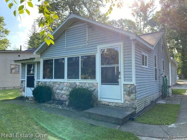This adorable cottage has 40ft on the Huron River leading to the Portage Chain of Lakes and lake access with Buck Lake. One large bedroom and 1 full & half bath. There is a very nice detach garage (20x26) with high ceilings. Roof, windows and siding were redone in 2002. Electric heat in living room. Porch sq ft is NOT included in total sq ft.