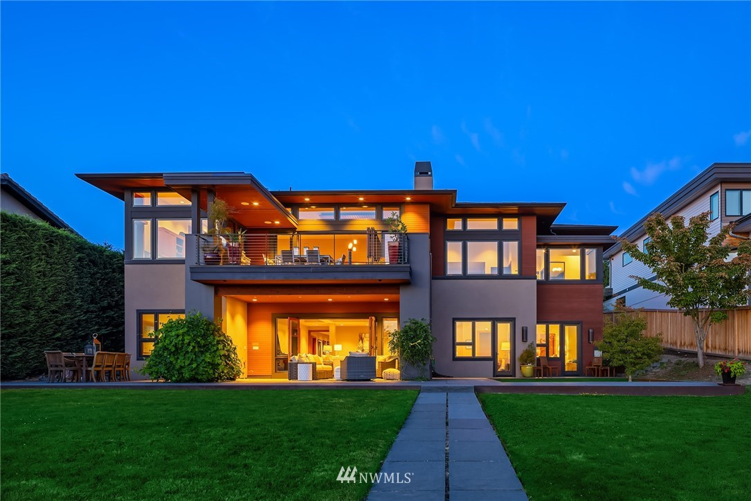 A Stunning Bender Chaffey Custom Home with interior updates by Krekow Jennings reveals sweeping views of Lake Washington, Olympic Mountains and the Seattle Skyline through accordion walls of glass on both floors. Impeccable Design and Quality Throughout; 12 foot ceilings frame modern, open living spaces with ample areas for work and play. Master Retreat with Steam Shower, Grand Walk-In wardrobe. Seamless indoor/ outdoor living on both levels with unlimited entertaining and relaxing Possibilities. Lower level Game/ Rec Room  opens to a covered fireplace and spacious Lake view yard. Wine cellar, gym, automated shades throughout. Sited along the Cross Kirkland Corridor Trail for an easy stroll to downtown Shops, Restaurants and the Waterfront.