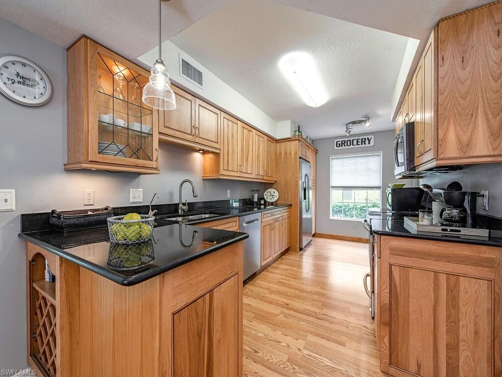 First Floor End unit, Upgraded cabinets in Kitchen & Baths, Granite, Stainless appliance and Private walk out Preserve View. Master walk in shower & custom closet. Covered carport parking. Use of two pools, Newly remodeled Clubhouse with Billards, fittness room, Tennis and more! This 2 Plus den with a large master is less than 8 miles to Beautiful Barefoot Beach and the ever fun Docs Beach house which also makes for the best Gulf Coast sunsets!  Near to shopping and dining & being offered partially furnished with a BUYER credit at closing. ( Agents please see confidential notes) New Hot-water heater was installed in 2020 You wont want to miss out on this affordable Gem!  Pets Welcome . Excellent investment, year round or seasonal home!