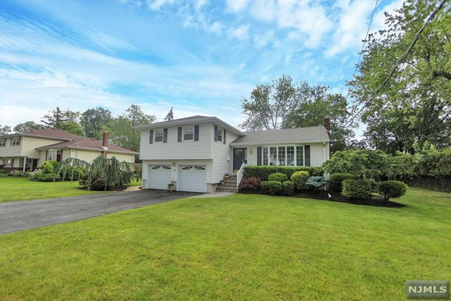 Beautiful Split level home on one of the most sought after blocks in the desirable town of Oradell. Walk right into your large and bright living room with vaulted ceilings which leads you into the formal dining room. Updated kitchen with brand new S/S appliances and granite countertops; sliding glass doors off the kitchen lead you to an oversized deck and a  parklike backyard. Upstairs features the main bedroom with full bath, 2 large bedrooms, and additional updated full bath. The ground level offers a spacious family room, half bath, laundry and garage access.  A brand new roof, a new hot water heater are just a few of the updates done in this home. This one is a must see!