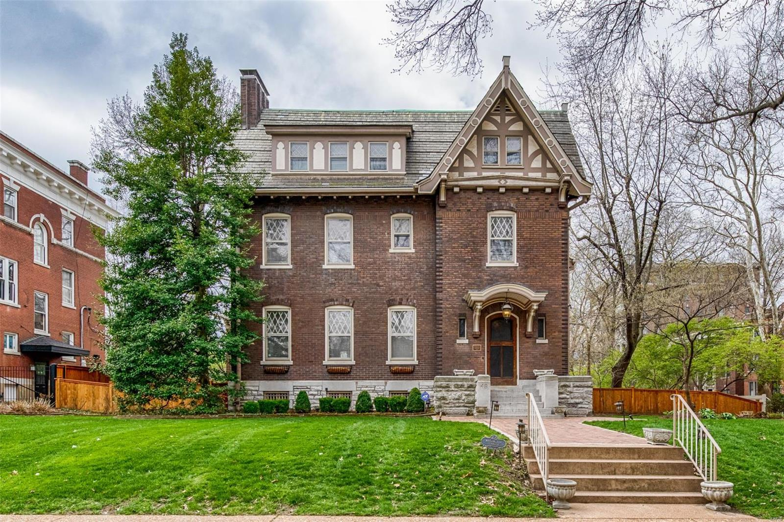 This 110 year old home was designed by forward-thinking World's Fair architect Louis Spiering.  The home truly combines the best of old world elegance and modern convenience. This gracious property is completely updated and light-filled while retaining its historic integrity. Located on one of the largest lots in the neighborhood and at the end of the street. Easy walk to Forest Park, coffee shops, restaurants, Metrolink and more.  You will love the ample closet and storage space throughout this home. Updated kitchen with 6-burner gas stove, center island, walk-in pantry, granite counters & breakfast room. Formal dining room with gothic paneling. Master Bedroom with walk-in closet, private balcony, sitting room & a updated bathroom with walk-in shower and jet tub. 3rd floor is finished with recreation space, 2 more bedrooms & 2 full bathrooms. 2-car garage. Just outside the backyard is the gate to leafy cul-de-sac Clara, flanked with upscale modern and historic condos.