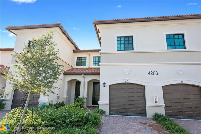 Modern Community of Fantastic Townhouses built in 2017 with the latest Construction Technology in Today's Market with Functional Design and Distribution. Perfect Home to entertain Family and Friends with our Open Layout Floor plan with High Ceiling, Gourmet Kitchen, Large Cabinetry, Stainless Steel Appliances, Quartz Counter Tops and Breakfast Bar, Tile Floors and Half Bathroom in Main Rooms for your Comfort. Three Large Bedrooms, 2 Full Modern Bathrooms and Laundry Room on Upper Level with High Ceiling. Large Closets and Walk-in Closets. High Impact Windows/Doors/Garage Door, 2-Year Old Spanish Tile Roof, 2-Year Old AC. The Fenced Community Offers Private Pool, Lake, Playground, Landscaped Gardens, Just minutes from Beaches, Restaurants, Bars, Supermarkets, Parks and I-95. Pet Friendly.