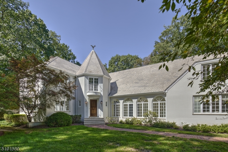 Elegant 5 bedroom French country manor, situated on 5+ private acres at top of Bernardsville Mountain.  With over 7300 sq ft of living space, this custom home features beautiful millwork & moldings, quality craftsmanship & great attention to detail. The spacious chef's kitchen offers leaded glass cabinetry, high end appliances & charming separate octagonal breakfast rm. French doors lead to the covered blue-stone rear porch with skylight that overlooks the heated, gunite in-ground pool. The custom wet bar with dishwasher & fridge is set between the grand LR with fireplace and the library with cherry wood wainscoting & built-ins . The 2nd floor boasts 5 generously sized bedrooms, incl. 3 en-suite.  A large finished basement & 1 bedroom apartment w/ private entrance complete this magnificent home!