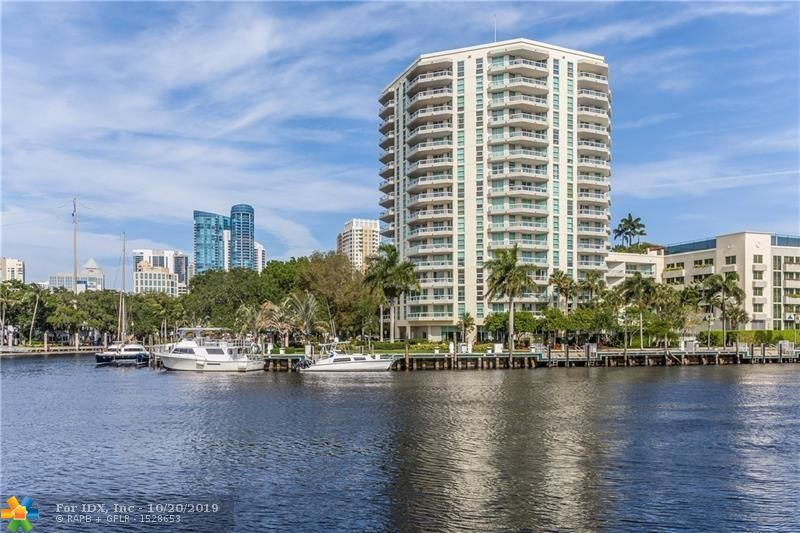Best views in the building! Direct waterfront views and city skyline! Boat lover's dream! The ultimate South Florida lifestyle. Direct waterviews from every room...each with balcony access. 2 deeded garage parking spaces. Free water trolley to various areas off the riverfront. Walking distance to Broward Performing Arts or take the free water trolley! Water and cable included along with Pool, tennis level with sunning area and outside lounge area, Gym, Business center, community room, 24 hour manned front desk. This building has it all and is very elegantly appointed. The unit has breathtaking views of the riverfront and skyline, an open kitchen and floor plan, Jacuzzi tub in mater bath, washer and dryer in unit, walk in closets and lot of storage. This is a unit that must not be missed.