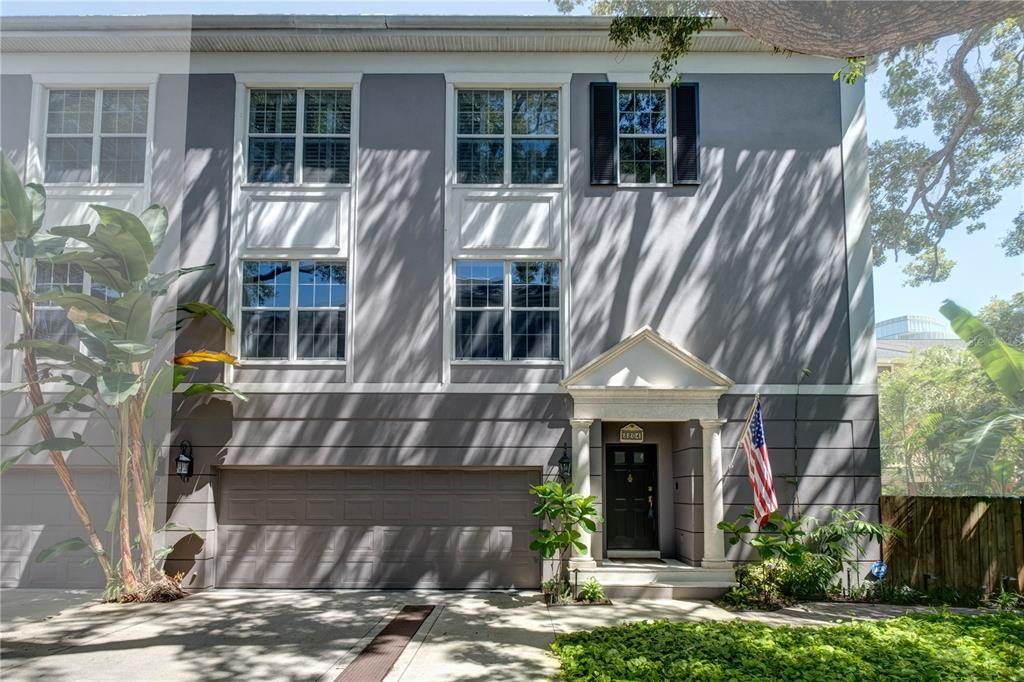This rare end unit, one of only nine all-block construction units, is quietly tucked away and framed amongst majestic oaks, but is closest to Bayshore Blvd., offering distant Bayshore water views. Inside, it features 10' ceilings, crown molding and plantation shutters throughout. Outside features the largest, most private outdoor retreat in the community, that looks over tropical foliage such as bamboo, banana and palm trees! Here's where you'll enjoy watching the birds and squirrels play in the large oak tree that provides cooling shade on a hot summer's day…whether inside or outside, the views seem like that of a tree house!   Inside you'll find a downstairs bedroom with a travertine floor and a closet right outside the door. If you'd prefer, though, it's also set up for you to install an elevator. That room has French doors leading out to the deck, which has a fan-cooled hanging daybed under a pergola and a custom fountain, both of which can convey if you'd like them. Potted plants/trees and kamado grill, wood bench seat, & cabinet do not convey. Back inside, stairs take you to the hardwood floors of the open and inviting main living area. The large windows offer views of the beautiful oak trees and bird-of-paradise growing just outside and the room is spacious enough to accommodate larger furniture. Between the living area and kitchen are a butler's pantry and powder room. Upstairs you'll find the other 2 bedrooms and bathrooms, with more large windows and gorgeous views. The guest room is ensuite. The main bedroom is spacious and if your attire is plentiful, the walk-in closet will put a big smile on your face. The location, secluded yet imminently accessible, simply can't be beat! Walk over to Bayshore, and you've got over five miles of contiguous sidewalk for breathtaking sunrise views over the water or just a long stroll where you'll routinely see dolphins swimming along the seawall. Hyde Park Village or downtown Tampa, with Amalie Arena and the convention c