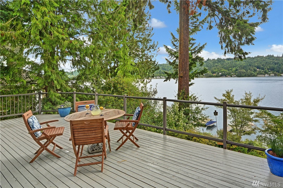 The BEST value on the lake & under $2M awaits!  World famous mountaineer, Jim Whittaker's former home on Lake Sammamish. Fittingly, epic Mountain Rainier, Cascade Mountain & lake views abound. This mid-century modern residence is nestled in a lush & native oasis. Massive lakefront deck for eagle watching & inspiring sunrises. Reminiscent of a tree house with alluring, fun spaces awaiting your personal touches. Great beach, 50' of waterfront, dock & lift. Great access to Microsoft, Google & 520.