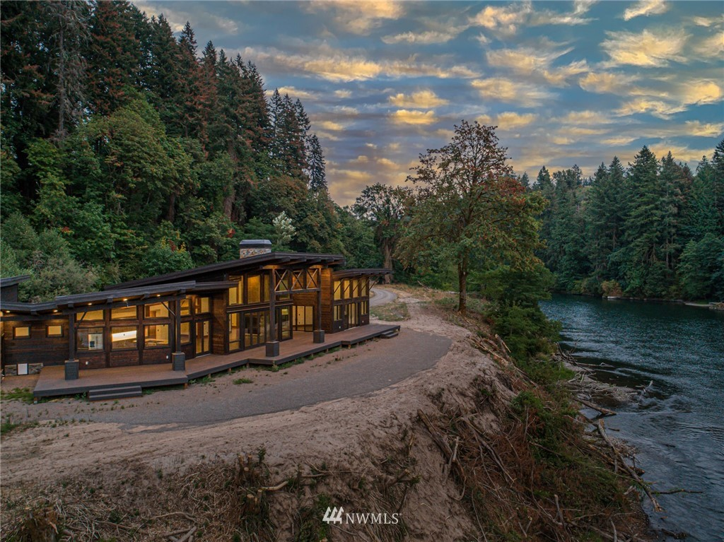 Over 750ft of Lewis River Front with Rare Boat Launch. VIEWS & PRIVACY. Thoughtfully constructed by PrecisionCraft Log & Timber Homes, this exquisite NW Contemporary styling is unique and timely. Live / work remotely, surrounded by light and nature. Only 36mi to PDX /139mi to SeaTac. Gorgeous timber frame construction with walls of glass providing the perfect panorama. Modern clean lines yet with warmth and character. Open great room, Gorgeous kitchen, Luxe Master suite. Room for your RV and more.  Large deck stretches the length of the home over the river. Paradise Found!